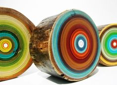 These small log slices are hand-painted in a swirling palette of amazing color combinations. I'd like several hanging on a wall together