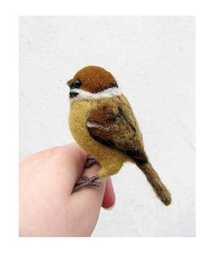 This Etsy seller is absolutely amazing! Her miniature felted animals are beyond perfection, and she has such a wide variety. People with talents like this just amaze me!    Needle felted tree sparrow