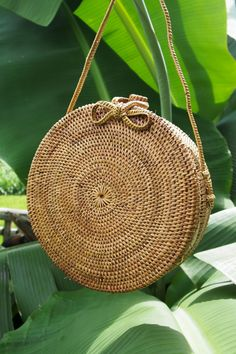 Round Island Bag Beautifully hand crafted rattan basket bag, ethically made in a small village in Eastern Bali. Ethically Made 100% Vegan Unique Batik lining In