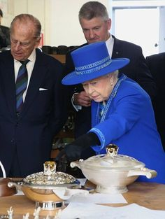 Prince Philip and Queen Elizabeth II visit the historic Hamilton and Inches jewellers in Edinburgh, 8 July 2016.