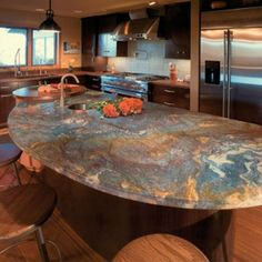What material is this counter top? reminds me of the beach - maybe good  with light grey cabinets