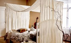 Hang a fabric of your choice over two poles to create an easy bedroom canopy