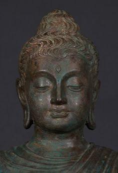 Image from http://i1132.photobucket.com/albums/m579/Abhigreen/p-gandhara-buddha-statue.jpg.
