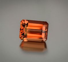Regal Rerun This is a wonderful vintage imperial topaz showing a perfect marriage of red and orange in a clean, large emerald cut gemstone. This is rare to find in the marketplace today. Pala International sold this gem in the 1970s and is delighted to offer it again