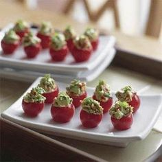 Make these stuffed cherry tomatoes as an appetizer for your next party. Your guests will love the colorful bite-sized treats.