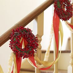 Ribbon Garland:   Instead of greenery, embellish your stair rail with ribbons and wreaths this year. Attach small winterberry wreaths to the railing with wire. Then drape the railing with lengths of ribbon, threading them through the wreath wires to create a swag.