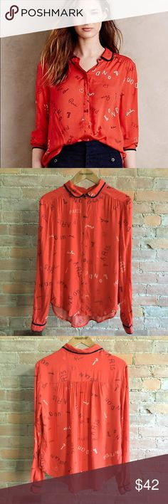 Anthropologie Maeve Art House Blouse red Maeve for Anthropologie Art House Blouse in the London - Paris - Milan typography print. Peter Pan collar and button cuffs. Bright cheerful red rayon. Excellent used condition with no flaws. Size 6. Anthropologie Tops Blouses
