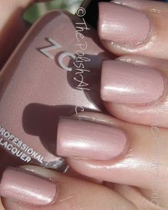 Zoya Pandora is a pink nude with mauve undertones and a silver pearl shimmer. #nail polish / lacquer / vernis