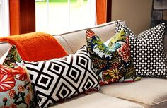love the mix of fabric on a neutral sofa, via Amanda Carol at Home