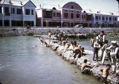 Men and boys washing and swimming in the Kabul River. Photograph by Bill Podlich, 1967-68