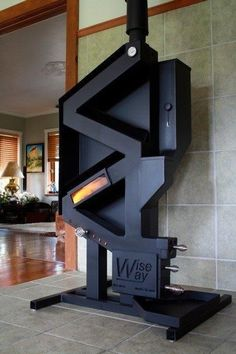 This is a rocket stove on steroids. A pellet stove that doesn't require electricity? You've found it, the WiseWay Pellet Stove. No noise, no moving parts, no electricity. Rocket Mass Heater, Stove Fireplace, Rocket Stoves, Wood Burner, Homestead Survival, Deco Design, Alternative Energy, Home Projects, Building A House