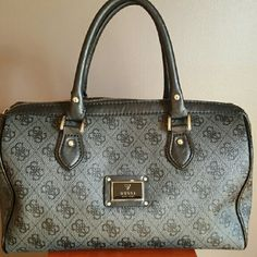 Guess Satchel Purse Guess bag that is gently used, it's in very good condition except for a minor stitching undoing(see pics). It's barely noticeable and could probably just be  clipped off. It's leather with the guess symbol as the pattern and design. Guess Bags Satchels