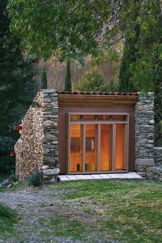 ruined mill reborn as modern cabin renovation with glass facade - south of France   Blee Halligan Architects