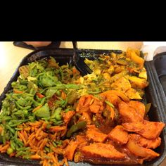 A shared meal of authentic Somali food at Midtown Global Market, Minneapolis
