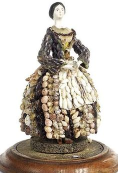 Early paper-mache sea shell doll.