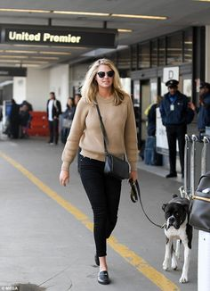 It's a dog's life: Kate Upton still looks glamorous in a sweater and jeans as she took her...