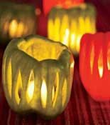 Cinco De Mayo tealight holders out of Bell Peppers: With a paring knife, cut thin strips or shapes out of the sides of red and green bell peppers, then cut off the tops and scoop out the seeds. Place a tea light at the bottom of each pepper.