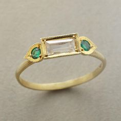 White Sapphire, Emerald and Glold Ring - Ila and Vikas