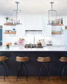 @Arteriors Home stools and the @The Urban Electric Co. pendants @mitchallenphoto