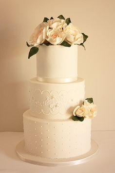 Ivory and lace wedding cake-beatiful, would be pretty with merlot ribbon