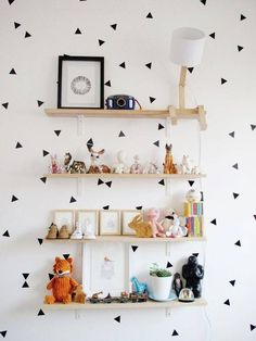 Stencil random triangles on the wall - so cute!  kids room design black and white polka dot wallpaper and mounted shelves