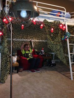 Soldier room. Camo netting and lantern string lights from Cabella's for his army fort under his loft bunk bed.