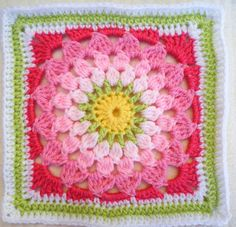 Kata Square with shades of pink and yellow and green center.