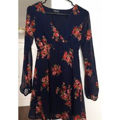 Forever 21 Floral Dress Floral dress from Forever 21. Navy with flower latter. Not my style and I have worn it once. Would look cute with boots. Want to get ride of! Size XS. Forever 21 Dresses
