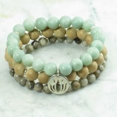 The Joy Mala Beads Stack is made from jade, thuja, and jasper mala beads. It is completed with a lotus. Yoga bracelet for health, abundance, heart chakra.
