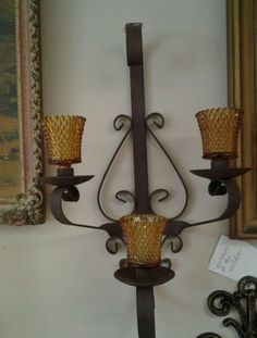 Antique wall sconce wrought iron with amber glass candle holders