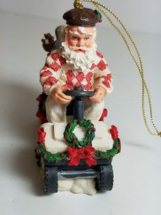Vintage Santa Claus Driving a Festive Golf Cart Christmas Ornament