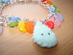 Kawaii whatever the weather Rainbow button bracelet with raindrop    £3.50