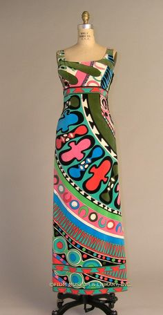 Print velveteen maxi dress by Emilio Pucci, Italian, 1964. The vibrant Pucci print seen on this dress was inspired by a trip to Africa in the early 1960s. Presented in the summer of 1964, the entire collection featured prints inspired by African masks on both silk jersey and the velveteen seen here.