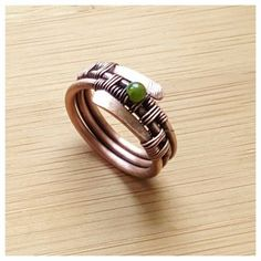 This listing is for one copper jade band ring. This gorgeouse wire wrapped ring is entirely handcrafted, hand woven with copper wire. Are you looking for a jade ring? Here it is! This unique copper ring can be a superb gift for bithday or for anniversary. This wire ring is oxidized with LOS for an antique look and gently polished by hand. Measurements: the inside diameter is 17.5mm/ the band is 1cm wide/ US size 7k