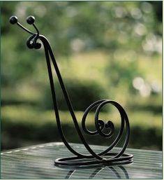 Snail Trellis - eclectic - garden sculptures - other metro - https://www.charlestongardens.com