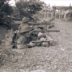 Soldiers of the Royal Welsh Fusiliers, 36th Infantry Division, man a position by the River Mu's weir in anticipation of an enemy counter attack, Burma, January 1945.