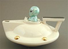 Extraterrestrial Tea Pot (Makes me laugh.) Andy Titcomb Creme UFO Teapot. Approximately 7'' long by 7'' wide by 7'' tall. $84.00