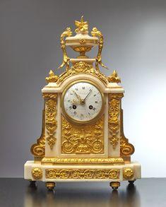 """A LOUIS XVI CLOCK BY JEAN-SIMON BOURDIER, PARIS, DATE CIRCA 1790 Jean-Simon Bourdier Signed on the white enamel dial Bourdier à Paris Gilt bronze and white marble Height 43 cm , width 29 cm, depth 10 cm ENQUIRE LITERATURE Elke Niehüser, """"Die Französische Bronzeuhr"""", 1997, p. 249, pl. 1034, illustrating a very similar clock."""