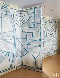 """A mural, by Mark Beard, inspired by Pablo Picasso's 1948 painting """"The Kitchen"""" in the New York apartment of Claire Weiss. Photo by Thomas Loof for Architectural Digest."""