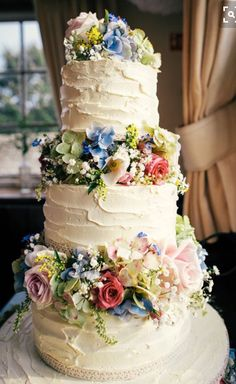 Love Wedding Cakes Homemade Village Hall Wedding Flowers Rustic Cake Home Baked Wedding Cake Rustic, Rustic Wedding Flowers, Beautiful Wedding Cakes, Beautiful Cakes, Amazing Cakes, Floral Wedding, Purple Wedding, Colourful Wedding Cake, Wedding Cake Flowers