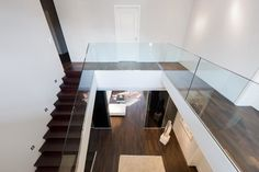 Beautiful Glass Stair Railing Design Examples To Inspire You : Modern L-shaped Stairs With Glass Staircase Railing Barrier At Villa Potsdam Kleinmachnow