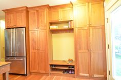 Mudroom - shaker cabinets, stained wood, pantry storage, bench, shoe storage, second refrigerator