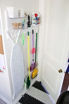 This next small space laundry room has several fun ideas to steal! Create instant storage using wooden craft crates spray painted to the color of your choice. Place pegboard on an empty wall to store small items. Use electrical tape to create an easy-to-remove design and pattern on your appliances.