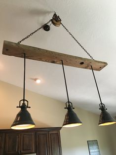 Barn wood pulley vaulted ceiling light fixture  Pendants are from Lowes