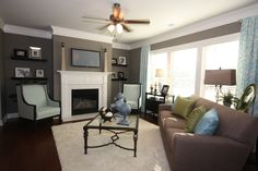Blue, brown, grey color scheme in the family room.