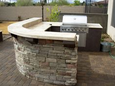 BBQ Coach has many different modules available to custom design your own outdoor kitchen. This island uses the Rounded Corner Module and Split Bar Counter Kit.