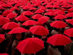 children with red umbrellas in China