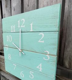 This rustic beach themed wall clock is made of pallet like wood. Painted and distressed with an aqua blue, white numbers, and white clock hands. * Clock measure