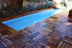 Above ground lap pool w wood deck.