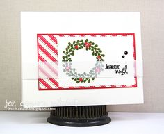 Fun and Festive Christmas Card Design with candy inspired stripes, a wreath and Joyeaux Noel